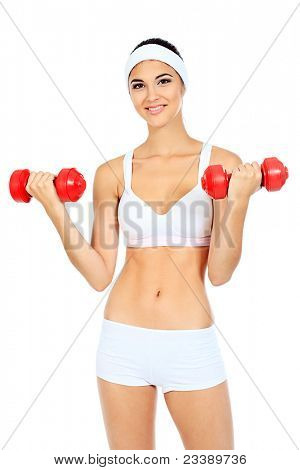 Shot of a sporty young woman with dumbbells. Active sporty life, wellness.
