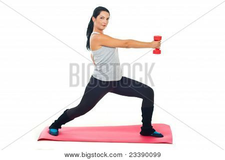 Woman Exercising With Red Barbell