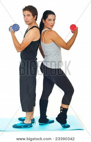 Young Couple Doing Fitness Exercises