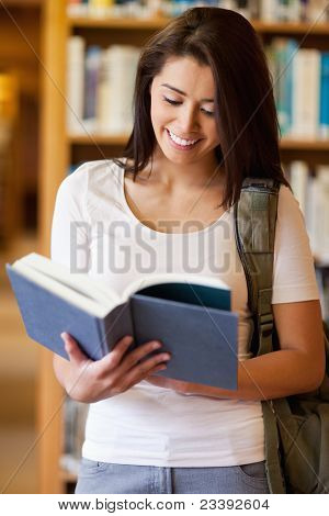 Portrait Of A Cute Student Reading A Book