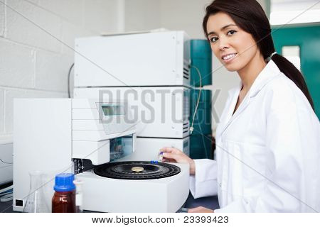 Female Scientist Using A Centrifuge