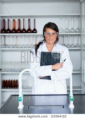 Portrait Of A Female Scientist Holding A Clipboard