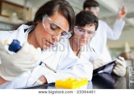 Three Scientists Working