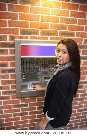 Portrait Of A Woman Withdrawing Cash