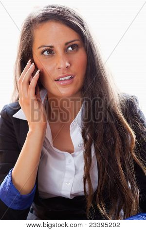 Portrait Of A Surprised Woman On The Phone