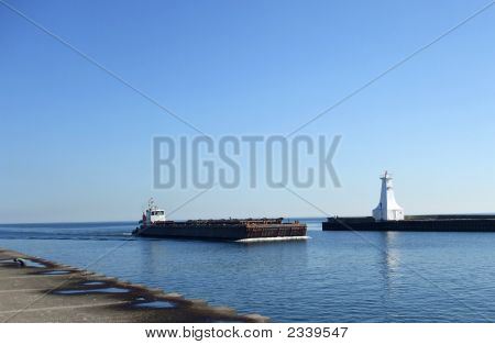 Barge And White Lighthouse