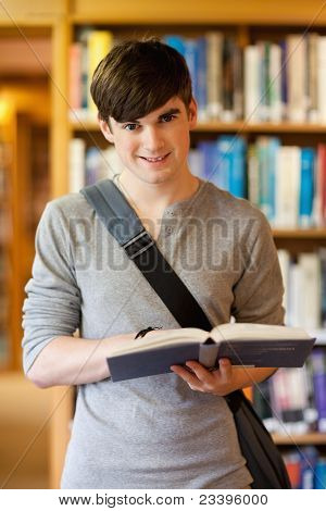 Portrait Of A Handsome Student Holding A Book
