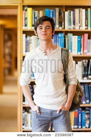 Portrait Of A Smiling Student Standing Up