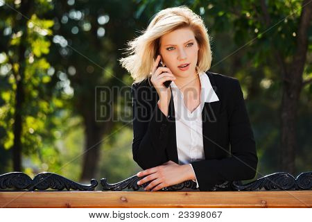 Surprised businesswoman calling on the mobile phone