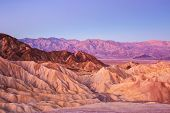Scenic view from Zabriskie Point, showing convolutions,  color contrasts, and texture in the eroded poster