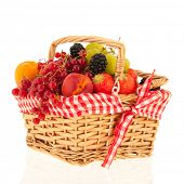 Wicker basket with fresh summer fruit isolated over white background poster