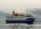 Tourist Ship In Front Of Glacial Wall poster