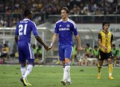 BUKIT JALIL, MALAYSIA - JULY 21: Chelsea's Kalou (21) speaks to Fernando Torres off the ball in this