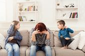 Kids Having Quarrel Over Tired Mother. Mom Is Depressed By Screaming Of Children. Problems Of Mother poster