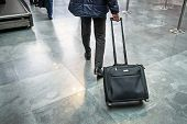 Man Traveller With Travel Suitcase Or Luggage Walking In Airport Terminal Walkway For Vacation Trave poster