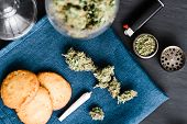 Cookies With Cannabis And Buds Of Marijuana On Table. A Can Of Cannabis Buds Concept Of Cooking With poster