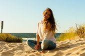 Young Joyful Girl On Beach. poster