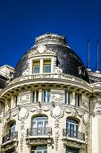 Historical Metropolis Building And Gran Via Main Shopping Street In Madrid, Spain. poster
