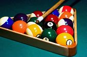 Racked Pool Balls, And A Cue Stick poster