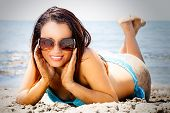 Sunglasses, Smiling Fashion Woman On The Sand. Holidays.  A Beautiful Woman With A Beautiful Smile I poster