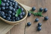 Fresh Wild Blueberries In Wood Basket On Sack. Wild Blueberry Put On Wooden Table With Copy Space Fo poster