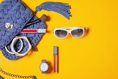 Top View Accessories For Woman. Stylish Eyewear, Blue Trendy Knitted Hand Made Bag, Violet Watch , L poster