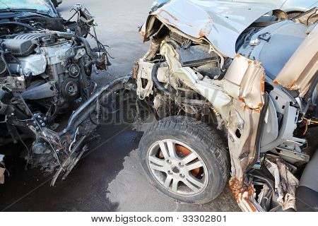 Creased hoods with bare motors of two collided cars after horrible accident
