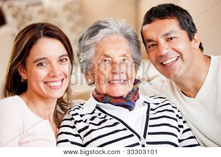Beautiful portrait of a mother, son and daughter-in-law smiling