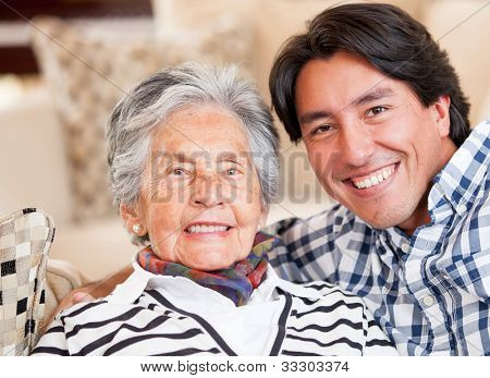 Happy portrait of a grandmother and her grandson smiling
