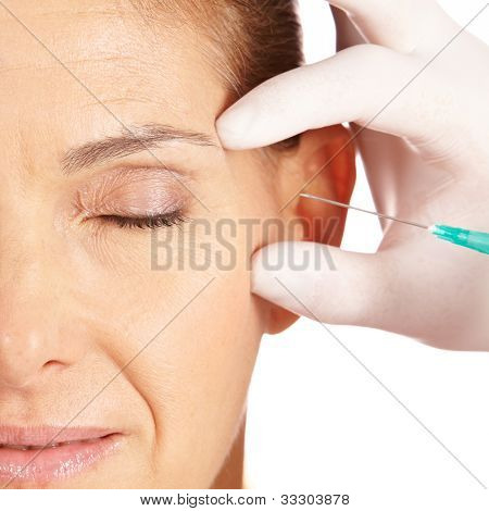 Elderly woman getting her eye wrinkles and crows feet removed