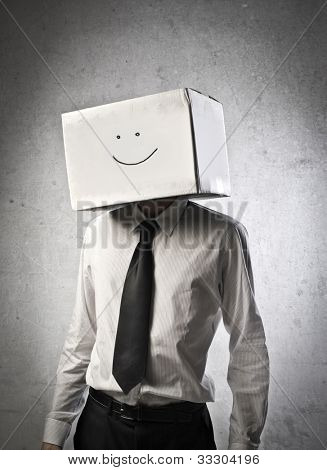 Young businessman wearing a carton with a smiley face on it