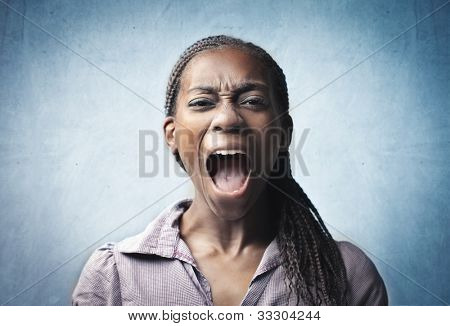 Angry young african woman screaming