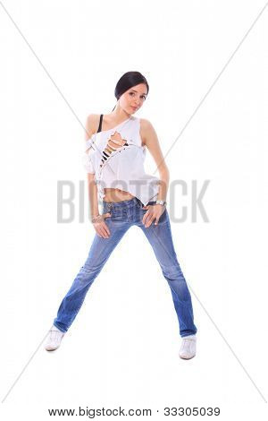 Fashion girl wearing white shirt and jeans in studio