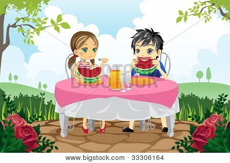 Kids Eating Watermelon In A Park