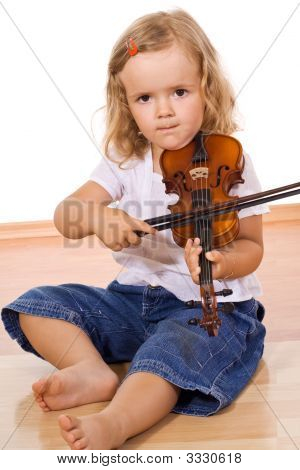 Little Girl Practicing The Violin