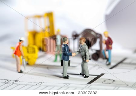 Building Site And Blueprint