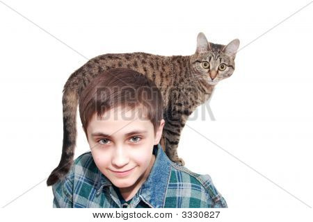 A Smiling Boy With A Cat