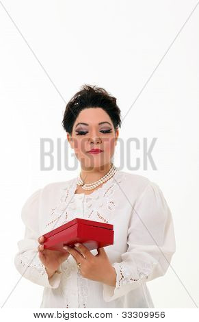 Pretty Plus Size Woman Opening A Gift