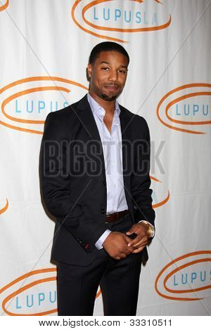 LOS ANGELES - MAY 24:  Michael B. Jordan arrives at the 12th Annual Lupus LA Orange Ball at Beverly Wilshire Hotel on May 24, 2012 in Beverly Hllls, CA