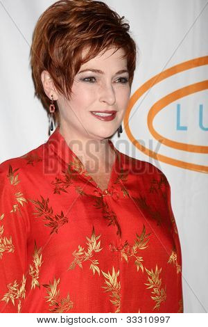 LOS ANGELES - MAY 24:  Carolyn Hennesy arrives at the 12th Annual Lupus LA Orange Ball at Beverly Wilshire Hotel on May 24, 2012 in Beverly Hllls, CA