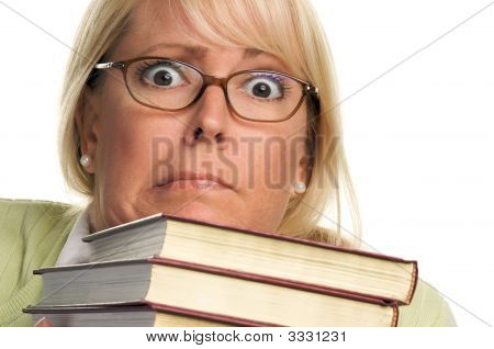 Worried Woman Fumbles With Stack Of Books