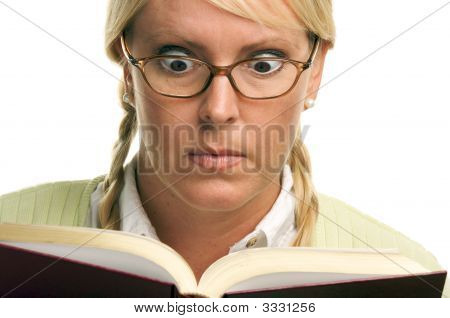 Stunned Female With Ponytails And Book