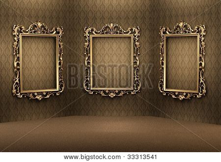 Empty Golden Frames On The Wall In Luxurious Interior. Royal Apartment. Showroom