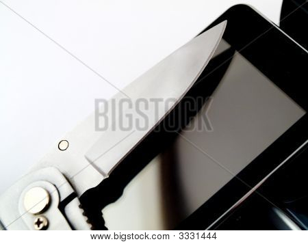 Modern Touchscreen Mobile Phone And Hunting Utility Knife Blade On White Background