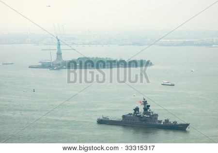 NEW YORK - MAY 23: The Japanese Navy ship, JS Shirane, moves through New York Harbor, past the Statue of Liberty, while arriving for the 25th annual Fleet Week celebration on May 23, 2012 in New York.