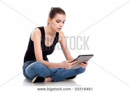 Teen Girl Using A Tablet