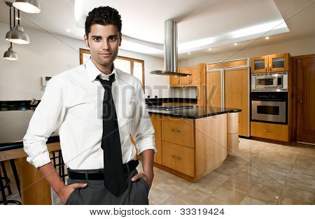 successful man at his new modern big kitchen