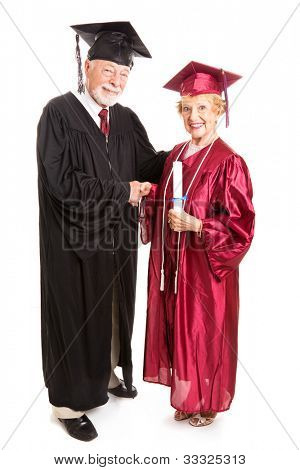 Senior woman graduating and receiving her degree from the dean.  Isolated on white, full body.