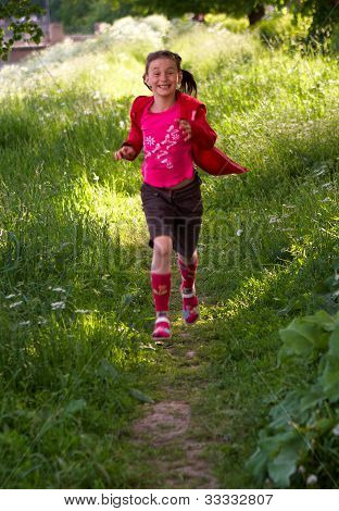 Pretty young girl running in the park