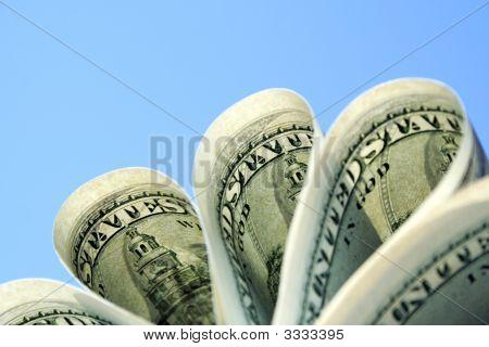 Dollars On Sky Background